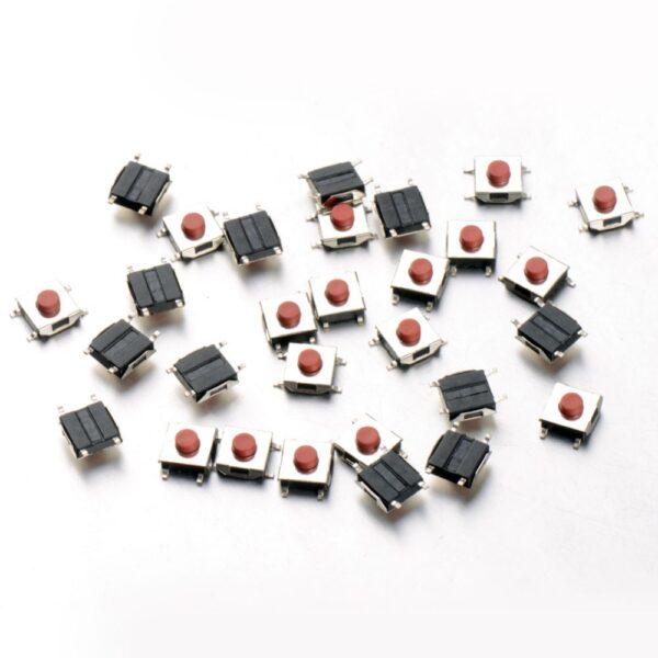 20x Mini Pulsador SMD 6.6x2.5mm con toque rojo en el tablero